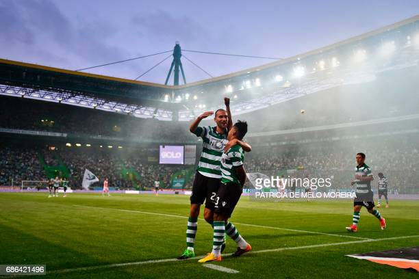 Sporting's Brazilian forward Matheus Pereira celebrates with his teammate Sporting's Dutch forward Bas Dost after scoring during the Portuguese...