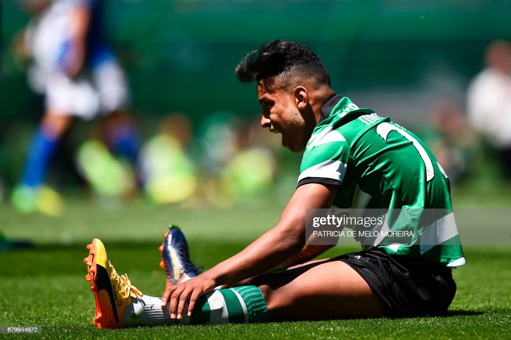 Sporting's Brazilian forward Matheus Pereira sits on the field after missing a goal opportunity during the Portuguese league football match Sporting CP vs OS Belenenses at the Jose Alvalade stadium in Lisbon on May 7, 2017. /