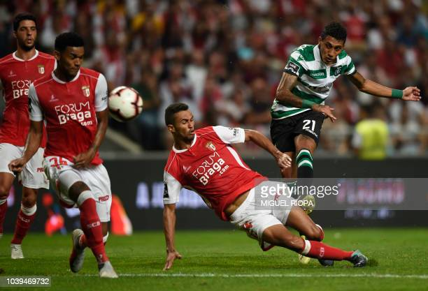Sporting's Brazilian forward Raphinha kicks the ball next to Sporting Braga's Brazilian defender Pablo Santos during the Portuguese league football...