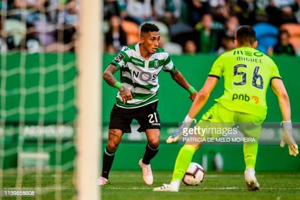 Sporting's Brazilian forward Raphinha shoots to score a goal during the Portuguese League football match between Sporting Lisbon and Vitoria de...
