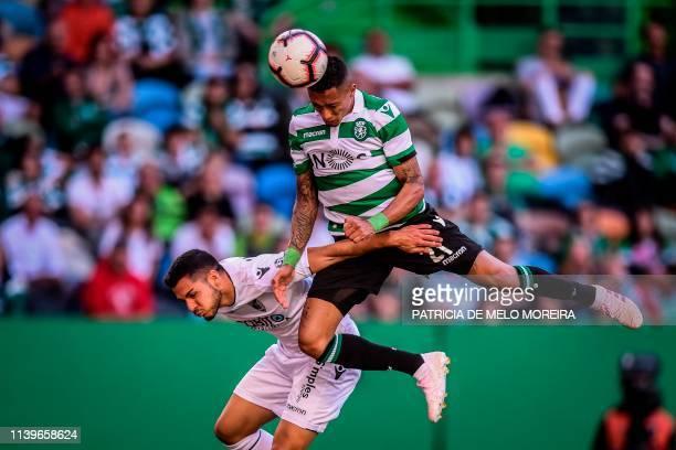 Sporting's Brazilian forward Raphinha vies with Guimaraes' Portuguese defender Rafa Soares during the Portuguese League football match between...