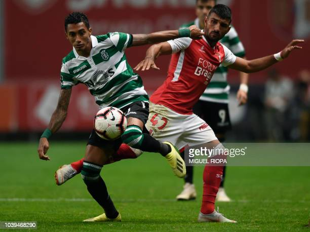 Sporting's Brazilian forward Raphinha vies with Sporting Braga's Portuguese forward Ricardo Esgaio during the Portuguese league football match...