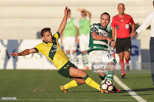 Sporting's Brazilian midfielder Bruno Cesar in action with Pacos Ferreira's Portuguese midfielder Pedrinho during the Premier League 2016/17 match...