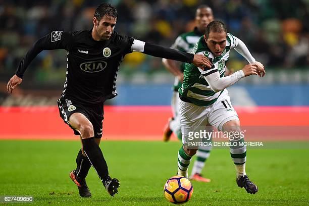 Sporting's Brazilian midfielder Bruno Cesar vies with Setubal's defender Frederico Venencio during the Portuguese league football match Sporting CP...