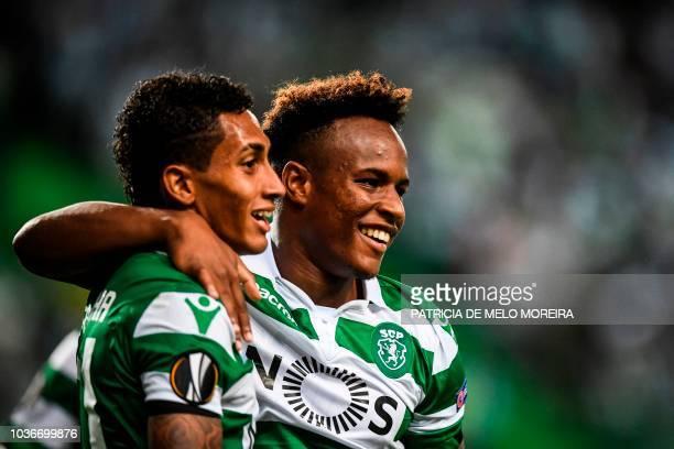 Sporting's Cape Verdean forward Jovane Cabral celebrates a goal with teammate Brazilian forward Raphinha during the UEFA Europa League group E...