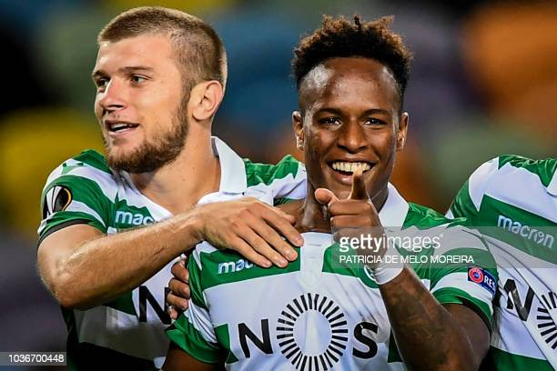 Sporting's Cape Verdean forward Jovane Cabral celebrates a goal with teammate Macedonian defender Stefan Ristovski during the UEFA Europa League...