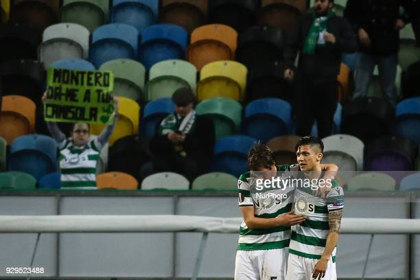 Sporting's Colombian forward Fredy Montero celebrates a goal with Sporting's defender Fabio Coentrao during the UEFA Europa League round of 16 match...