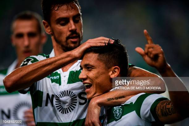 Sporting's Colombian forward Fredy Montero celebrates with his teammate Sporting's defender Andre Pinto after scoring during the Portuguese league...