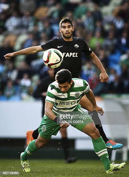 Sporting's Colombian forward Fredy Montero vies with Academica's defender Anibal Capela during the Portuguese league football match Sporting vs...