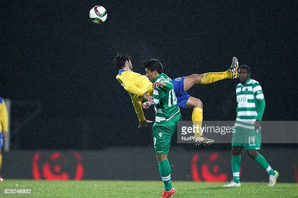 Sporting's Colombian forward Fredy Montero vies with Arouca's Portuguese midfielder Nuno Coelho during the Premier League 2014/15 match between FC...