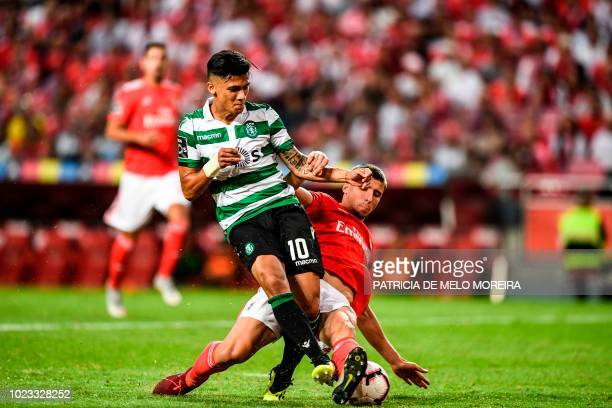 Sporting's Colombian forward Fredy Montero vies with Benfica's defender Ruben Dias during the Portuguese league football match between SL Benfica and...