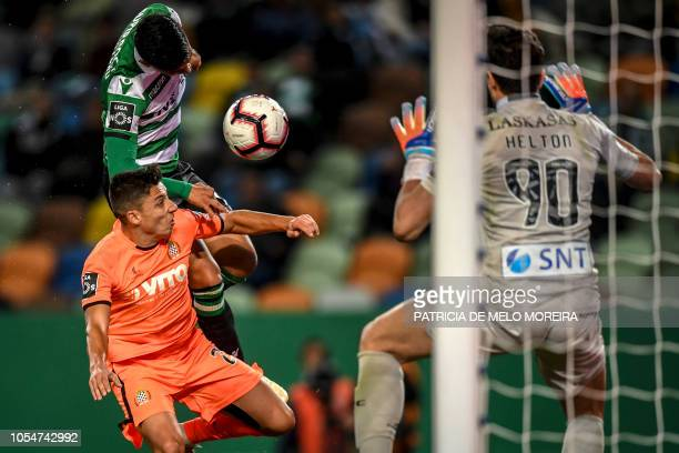 Sporting's Colombian forward Fredy Montero vies with Boavista's defender Edu Machado during the Portuguese league football match between Sporting CP...
