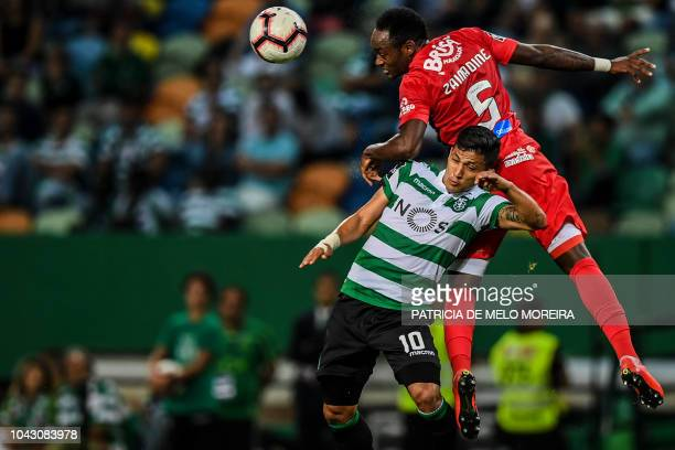 Sporting's Colombian forward Fredy Montero vies with Maritimo's Mozambican defender Zainadine Junior during the Portuguese league footbal match...