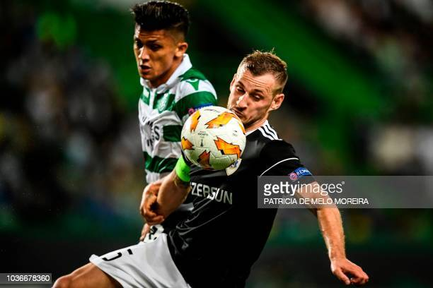 Sporting's Colombian forward Fredy Montero vies with Qarabag's defender Maksim Medvedev during the UEFA Europa League group E football match between...