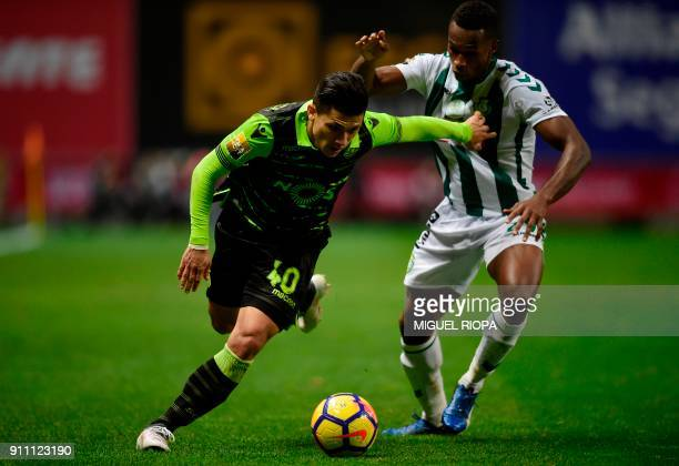 Sporting's Colombian forward Fredy Montero vies with Vitoria FC's Portuguese defender Semedo during the Portuguese Cup final football match between...