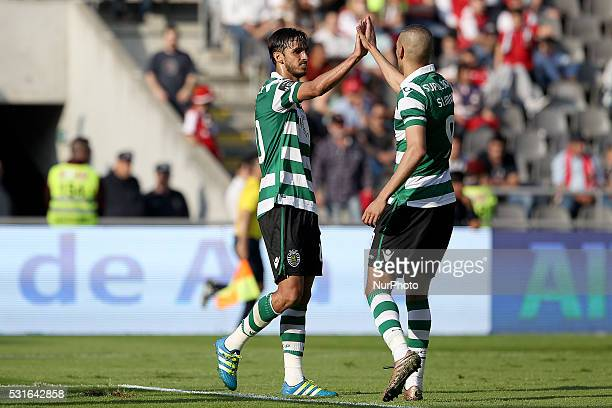 Sporting's Costa Rica forward Bryan Ruiz celebrates after scoring a goal with Sporting's Algerian forward Islam Slimani during the Premier League...