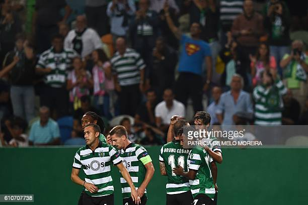 Sporting's Costa Rican forward Bryan Ruiz celebrates a goal with teammates during their UEFA Champions League football match between Sporting CP and...