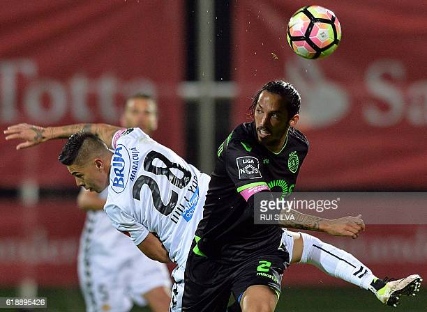 Sporting's Costa Rican forward Bryan Ruiz vies with Nacional's Brazilian midfielder Willyan Barbosa during the Portuguese league football match...