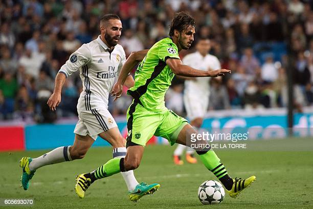Sporting's Costa Rican forward Bryan Ruiz vies with Real Madrid's defender Dani Carvajal during the UEFA Champions League football match Real Madrid...