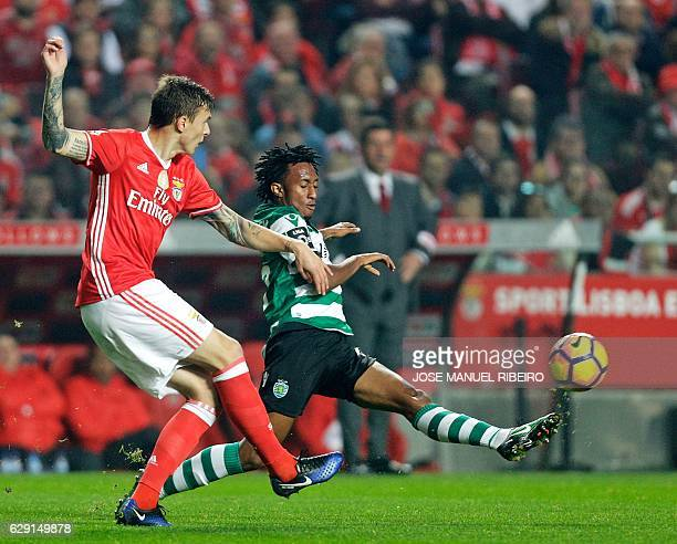 Sporting's Costa Rican forward Joel Campbell vies with Benfica's Swedish defender Victor NilssonLindelof during the Portuguese league football match...