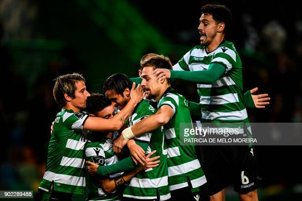 Sporting's Costa Rican midfielder Bryan Ruiz celebrates with teammates after scoring a goal during the Portuguese League football match Sporting CP...