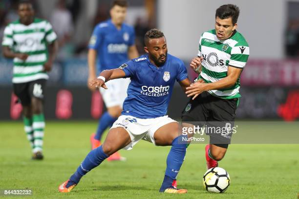 Sporting's defender Acuna vies with Feirense's Brazilian forward Edson Farias during the Premier League 2017/18 match between CD Feirense and...