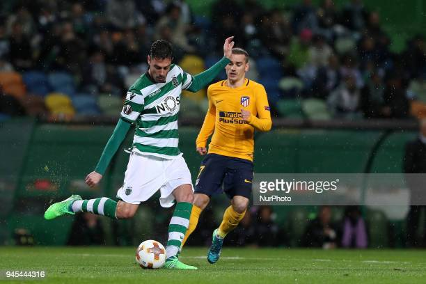 Sporting's defender Andre Pinto from Portugal vies with Atletico Madrids forward Antoine Griezmann of France during the UEFA Europa League second leg...