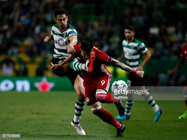 Sporting's defender Andre Pinto vies for the ball with Olympiakos's forward Uros Djurdjevic during Champions League 2017/18 match between Sporting CP...