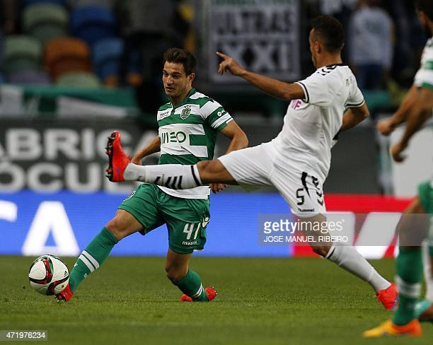 Sporting's defender Cedric Soares vies with Nacional's Brazilian defender Marcal Oliveira during the Portuguese Liga football match Sporting CP vs CD...