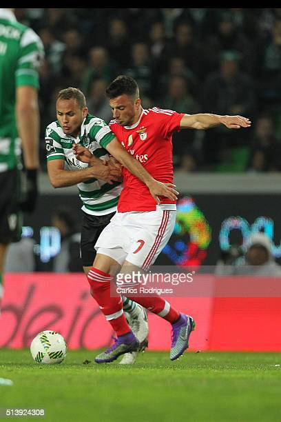 Sporting's defender Ewerton vies with Benfica's midfielder Andreas Samaris during the match between Sporting CP and SL Benfica for the Portuguese...