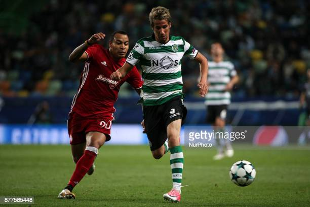 Sportings defender Fabio Coentrao and Olympiakos Piraeus midfielder Felipe Pardo during the UEFA Champions League group D match between Sporting CP...