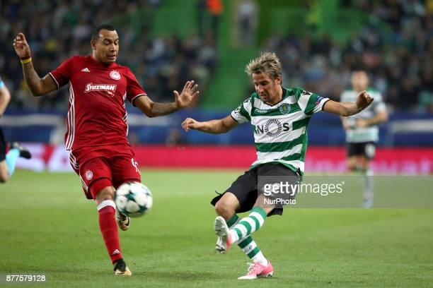 Sporting's defender Fabio Coentrao from Portugal vies with Olympiacos' Colombian midfielder Felipe Pardo during the UEFA Champions League group D...