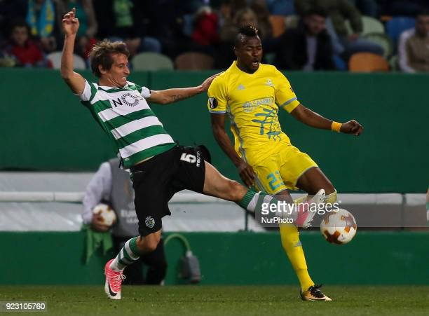 Sporting's defender Fabio Coentrao nvies with Astana's forward Patrick Twumasi from Ghana during the UEFA Europa League football match between...