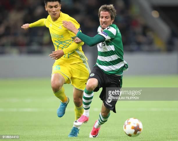 Sporting's defender Fabio Coentrao outruns Astana's midfielder Abzal Beysebekov during the Europa League Round of 32 first leg football match between...