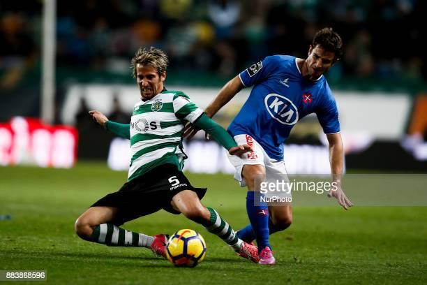 Sporting's defender Fabio Coentrao vies for the ball with Belenenses's midfielder Bruno Pereirinha during Primeira Liga 2017/18 match between...