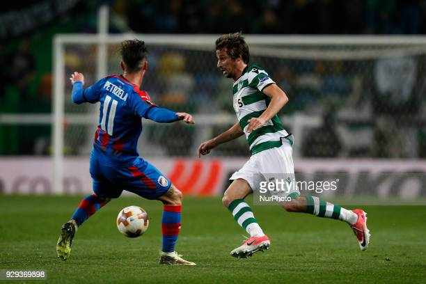 Sporting's defender Fabio Coentrao vies for the ball with Plzen's midfielder Milan Petrzela during UEFA Europa League football match between Sporting...