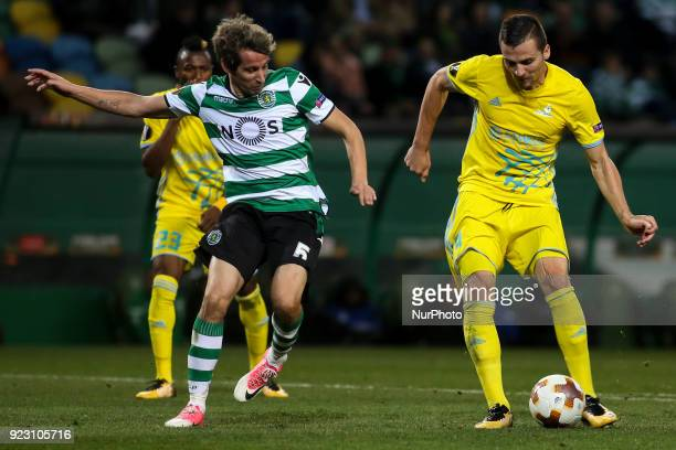 Sporting's defender Fabio Coentrao vies with Astana's forward Djorde Despotovic from Serbia during the UEFA Europa League football match between...