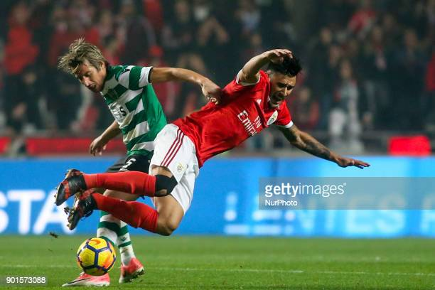 Sporting's defender Fabio Coentrao vies with Benfica's forward Eduardo Salvio during the Portuguese League football match between SL Benfica and...