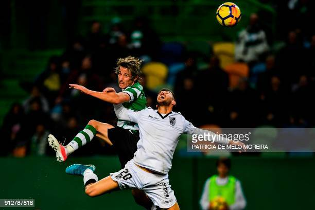 Sporting's defender Fabio Coentrao vies with Guimaraes' defender Joao Aurelio during the Portuguese league football match between Sporting CP and...