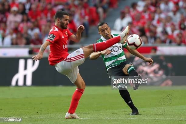 Sporting's defender Jefferson from Brazil vies with Benfica's Portuguese midfielder Rafa Silva during the Portuguese League football match SL Benfica...