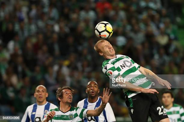 Sporting's defender Jeremy Mathieu from France heads the ball during the Portugal Cup semifinal second leg football match Sporting CP vs FC Porto at...