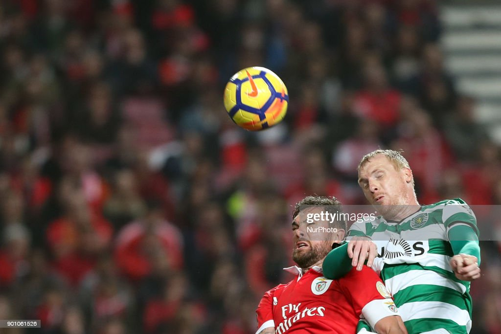 Sporting's defender Jeremy Mathieu from France (R ) heads the ball with Benfica's Brazilian defender Jardel during the Portuguese League football match SL Benfica vs Sporting CP at the Luz stadium in Lisbon on January 3, 2018.