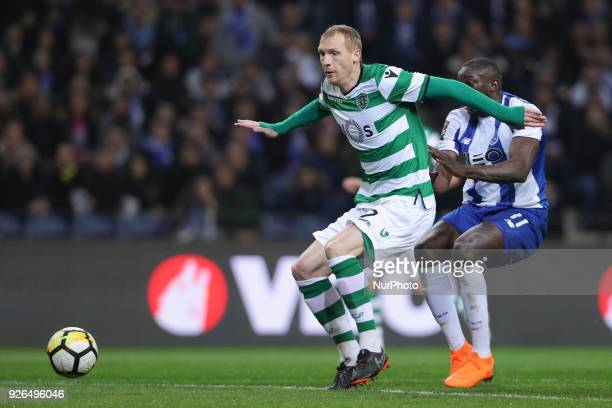 Sporting's defender Jeremy Mathieu vies with Porto's Malian forward Moussa Marega during the Premier League 2017/18 match between FC Porto and...