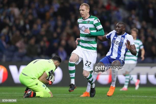 Sporting's defender Jeremy Mathieu vies with Porto's Malian forward Moussa Marega and Sporting's Portuguese goalkeeper Rui Patricio during the...