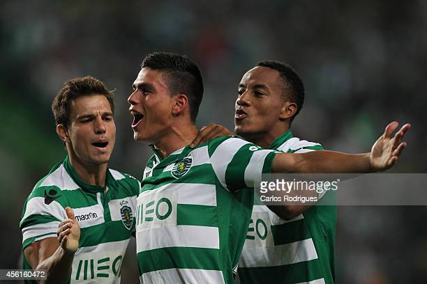 Sporting's defender Jonathan Silva celebrates scoring Sporting's goal with Sporting's defender Cedric and Sporting's forward Andre Carrillo during...