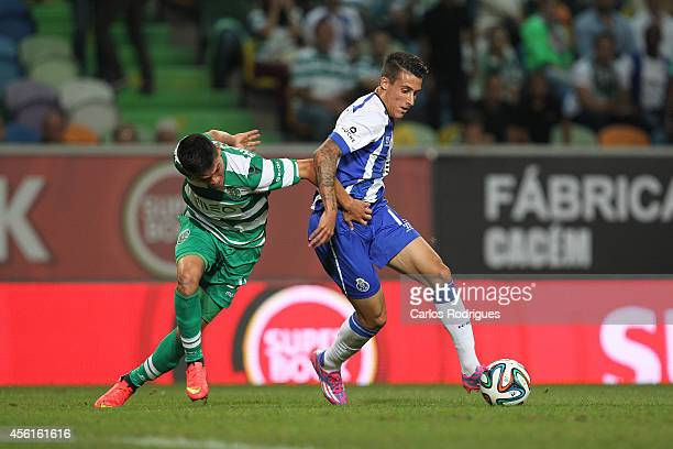Sporting's defender Jonathan Silva grabs Porto's forward Cristian Tello during the Primeira Liga match between Sporting CP and FC Porto at Estadio...