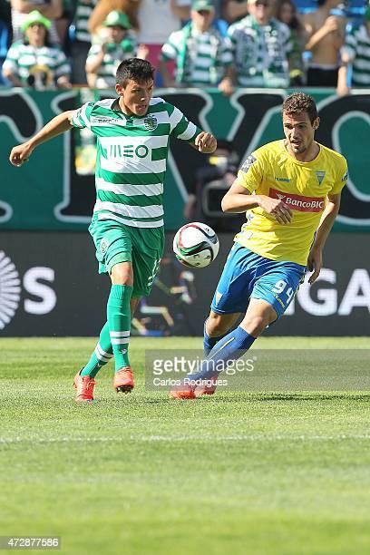 Sporting's defender Jonathan Silva vies with Estoril's forward Leo Bonatini during the Prmeira Liga match between Estoril and Sporting CP at Estadio...