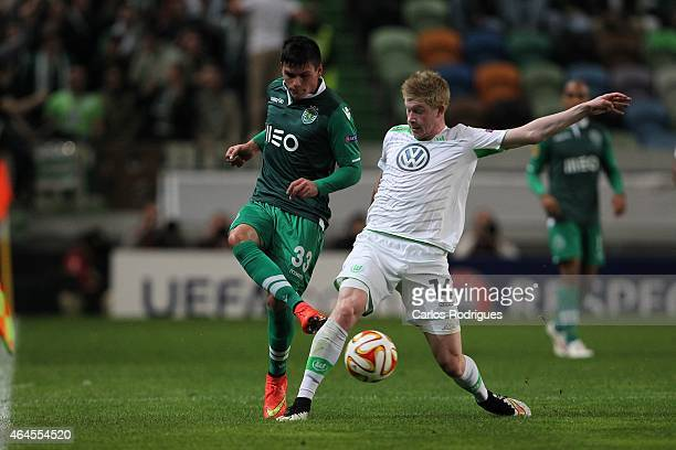 Sporting's defender Jonathan Silva vies with Wolfsburg's midfielder Kevin De Bruyne in action during the UEFA Europa League Round of 32 match between...