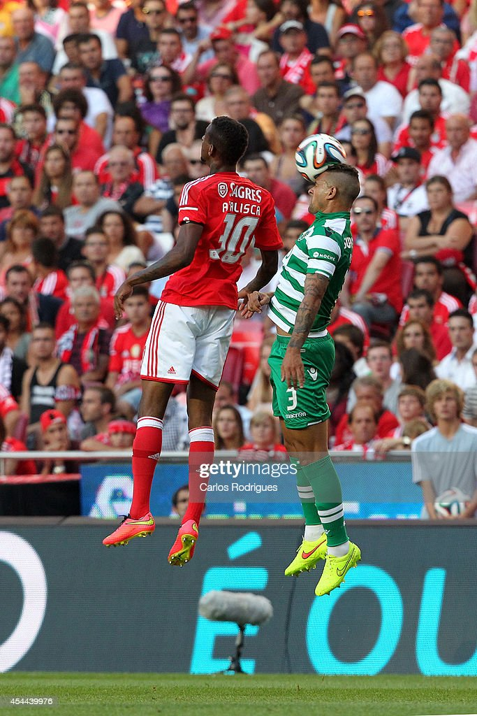 Sporting's defender Mauricio vies with Benfica's midfielder Talisca during the Primeira Liga match between SL Benfica and Sporting CP at Estadio da Luz on August 31, 2014 in Lisbon, Portugal. (Photo by Carlos Rodrigues/Getty Images).