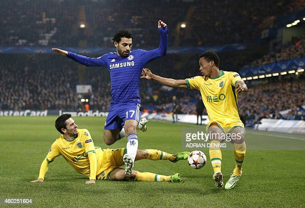 Sporting's defender Paulo Oliveira and Sporting's Peruvian forward Andre Carillo challenge Chelsea's Egyptian midfielder Mohamed Salah during the...